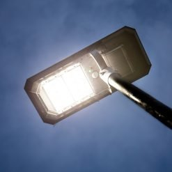 solar powered light on tall pole for lighting pathways, walkways and pedestrian traffic areas