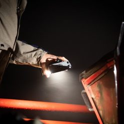 farmer using handheld solar torch in Australia