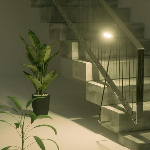 small security light shining on steps inside apartment complex