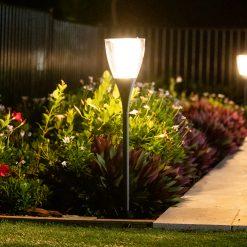 stylish solar garden light on stand in Brisbane backyard