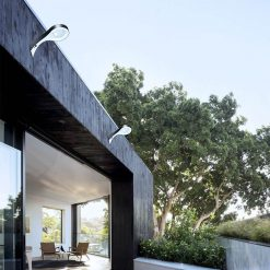 solar outdoor wall mounted lights shining on courtyard of Brisbane house