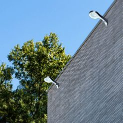 wall mounted solar wall lights shining onto outdoor patio of house in Brisbane