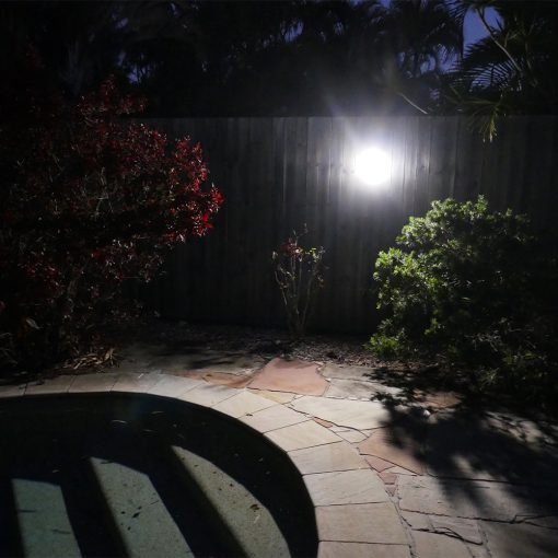 camping light shining brightly on swimming pool area