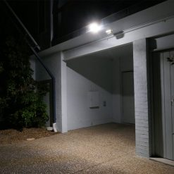 Motion detecting security light above garage turning on when thief walks past