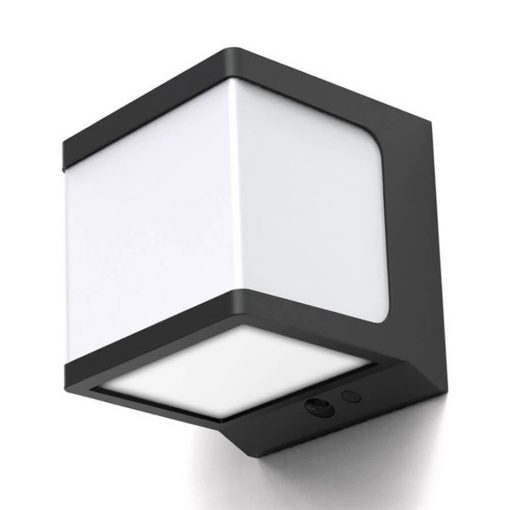 cube shaped solar security wall light shining in garden